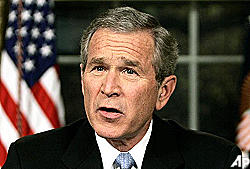 President Bush used for publicity ploy by seminar-selling group?