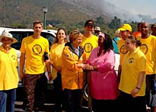 Scientology volunteers take time out from fire for photo op