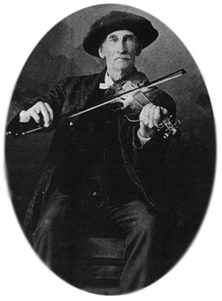 Hubbard's great-grandfather playing a fiddle carved with a negro's head