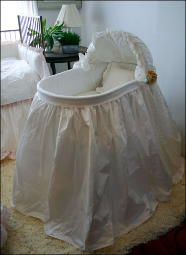 Fancy bassinet bought, but no baptism